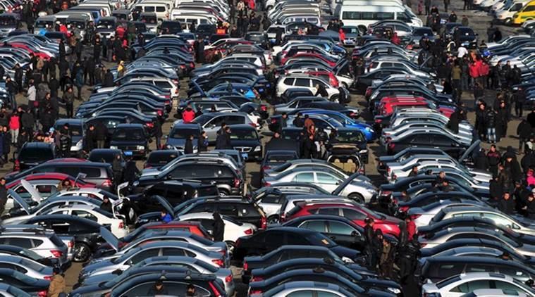 People select automobiles at a second-hand market in Shenyang, Liaoning province, in this December 10, 2011 file photo. Auto sales in China were flat in the first eight months of 2015 and could drop this year for the first time since the market took off in the late 1990s. REUTERS/Sheng Li/Files