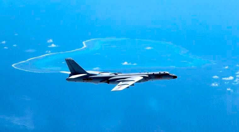 FILE - In this undated file photo released by Xinhua News Agency, a Chinese H-6K bomber patrols the islands and reefs in the South China Sea. China is pitted against smaller neighbors in multiple disputes over islands, coral reefs and lagoons in waters crucial for global commerce and rich in fish and potential gas and oil reserves in the South China Sea. (Liu Rui/Xinhua via AP, File)