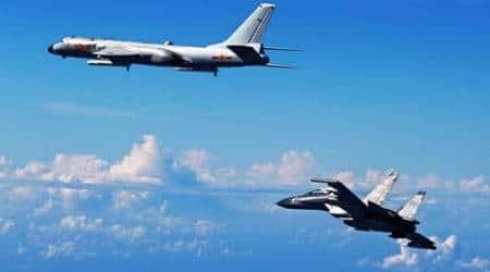 Japan, China, war planes, military activities, south china sea, air force drill, china air force drill, china drill, Yoshihide Suga, military drill, Miyako Strait, world news, indian express, latest news
