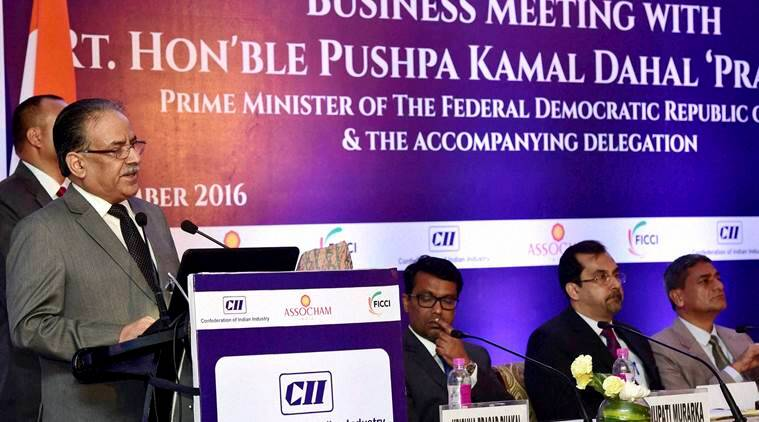 New Delhi: Nepal's Prime Minister Pushpa Kamal Dahal addresses a Business Meeting organised jointly by CII, FICCI and ASSOCHAM in New Delhi on Friday. PTI Photo by Kamal Kishore   (PTI9_16_2016_000367B)