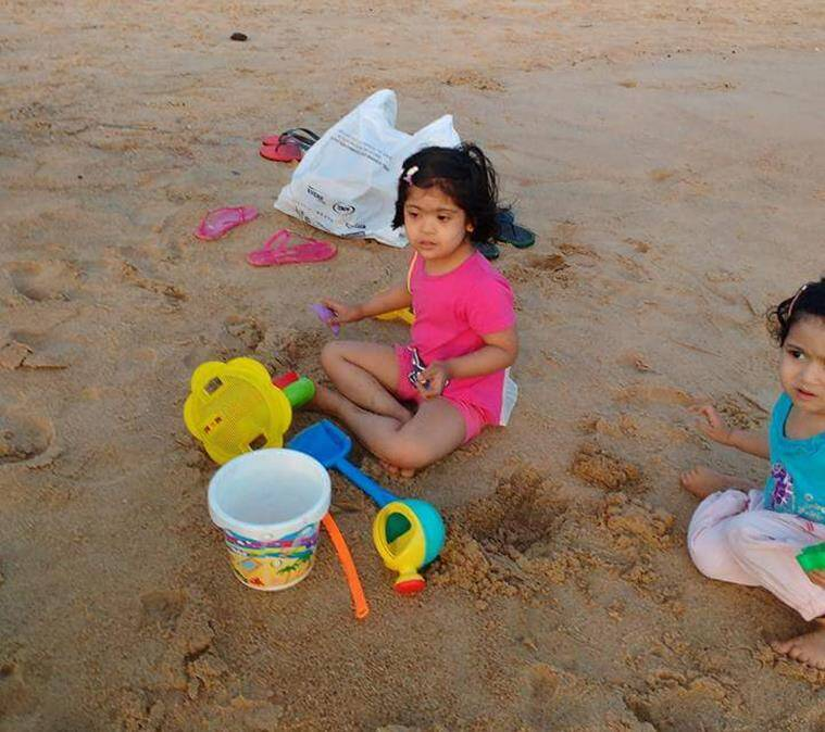 A child building sand castles at the beach.