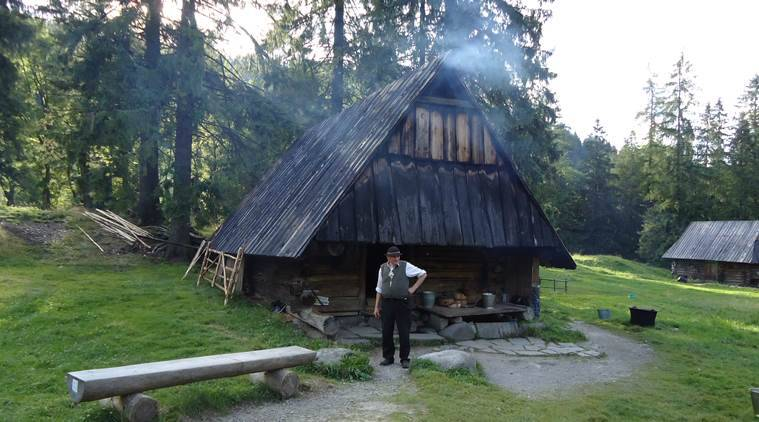 Andrzej Staszel-Furtek stands in front of his house, where he sells traditional