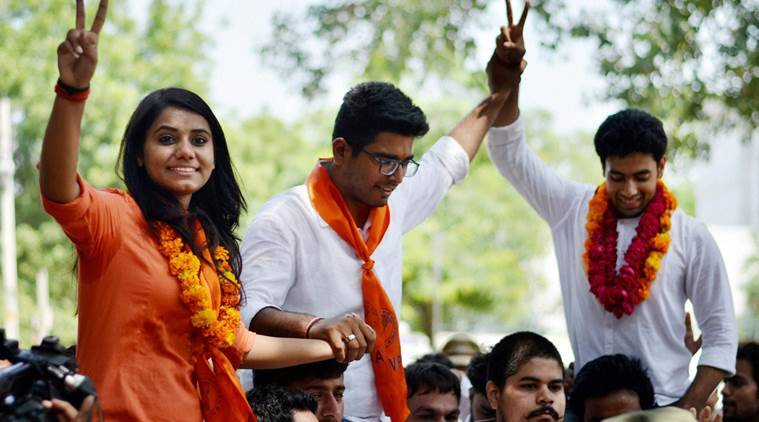 New Delhi: ABVP candidates Amit Tanwar, Priyanka Chabri and Ankit Sangwan celebrate their victory after winning the post of President, Vice President and Secretary in the 2016 DUSU elections in Delhi on Saturday. PTI Photo(PTI9_10_2016_000112B)