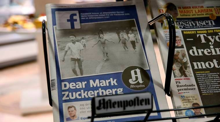 The cover to Norway's largest circulation newspaper, Aftenposten, displayed in Oslo Friday Sept. 9, 2016. Editor-in-chief and CEO, Espen Egil Hansen, wrote an open letter to founder and CEO of Facebook, Mark Zuckerberg, accusing him of threatening the freedom of speech and abusing power after deleting the iconic picture from the Vietnam war, taken by Associated Press photographer  Nick Ut, of a young girl running from a napalm attack. The Pulitzer Prize-winning image by Nick Ut is at the center of a heated debate about freedom of speech in Norway after Facebook deleted it from a Norwegian author's page. (Cornelius Poppe, NTB scanpix via AP)