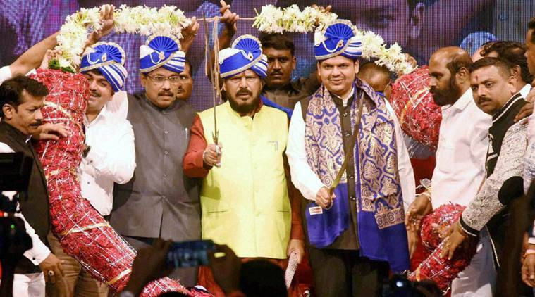 Mumbai: RPI Leader & Social Justice Minister Ramdas Athawale is felicitated by Chief Minister Devendra Fadnavis at Shanmukhanand Hall in Mumbai on Friday. PTI Photo (PTI9_2_2016_000381B)