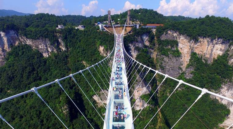 China, glass bridge, china glass bridge, china bridge, world's longest glass bridge, longest and highest glass bridge, highest glass bridge, glass bridge reopens, china glass bridge, china glass bridge reopens, world news, indian express, latest news