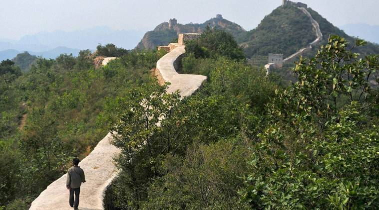 Suizhong : In this Wednesday, Sept. 21, 2016, photo, a villager walks across a restored section of the Great Wall in Suizhong County in northeastern China's Liaoning Province. Chinese officials are being pilloried over the smoothing-over of a crumbling but much-loved 700-year-old section of the Great Wall of China - a UNESCO World Heritage Site - in the name of restoration. AP/PTI(AP9_22_2016_000215B)