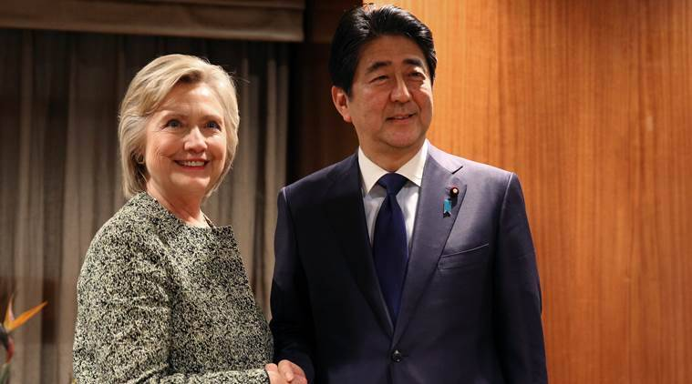 U.S. Democratic presidential candidate Hillary Clinton meets with Japan's Prime Minister Shinzo Abe at a hotel in New York, U.S. September 19, 2016. REUTERS/Carlos Barria
