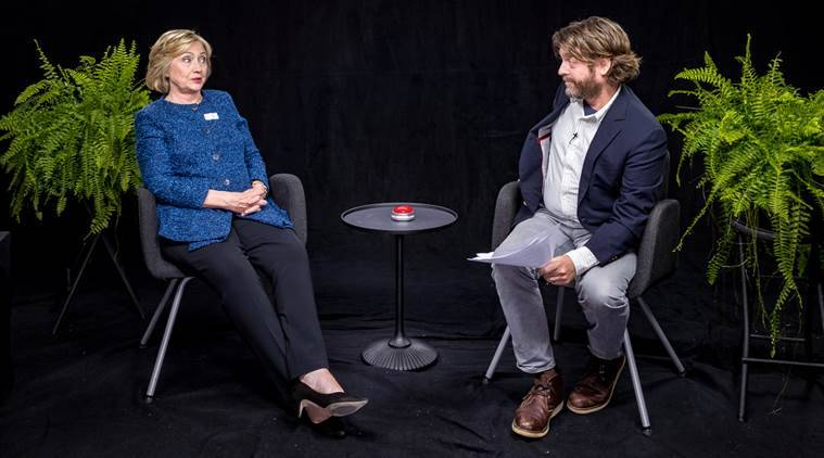 """Democratic presidential candidate Hillary Clinton, left, appears with actor-comedian Zach Galifianakis during an appearance for the online comedy series, """"Between Two Ferns."""" (FunnyorDie.com via AP)"""
