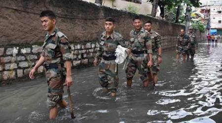 Hyderabad: Army personnel arrive to help flood affected people in Hyderabad on Saturday. PTI Photo. (PTI9_24_2016_000088B)