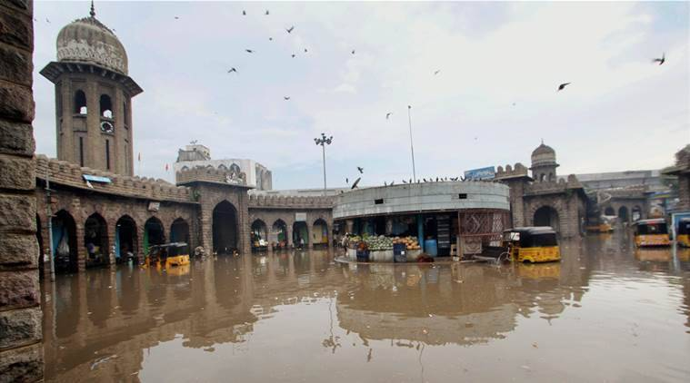 Hyderabad: A view of flooded Moazzam Jahi Market after heavy rains in Hyderabad on Thursday. PTI Photo (PTI9_22_2016_000226A)