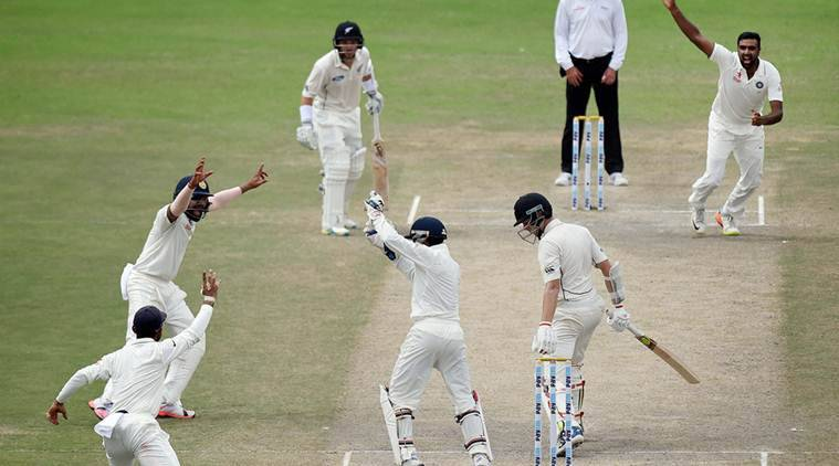 Kanpur: Indian players celebrate the wicket of New Zealand player Mitchell Santner, who was dismissed by R Ashwin, on the third day of the first Test match at Green Park in Kanpur on Saturday. PTI Photo by Atul Yadav(PTI9_24_2016_000043A)