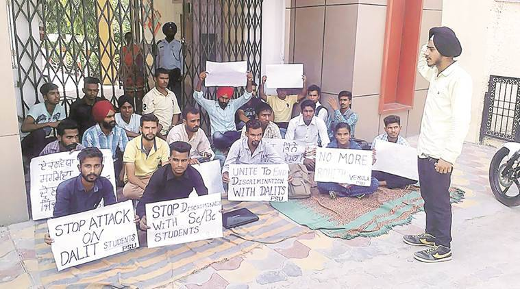 Students protest outside the institute. Express Photo by Gurmeet Singh