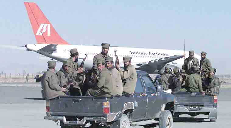 Taliban fighters on the tarmac of Kandahaar airport with the hijacked Indian Airlines aircraft in the background.