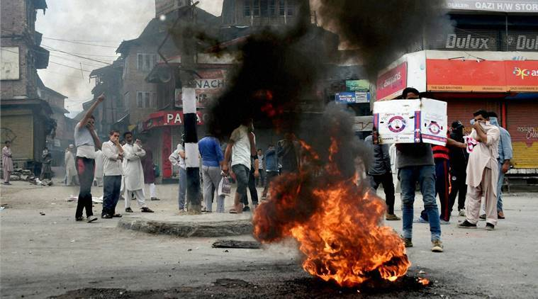 Srinagar: Protesters block a road by burning tyres during strike after curfew was completely lifted, in Srinagar on Wednesday. PTI Photo by S Irfan (PTI8_31_2016_000198B)