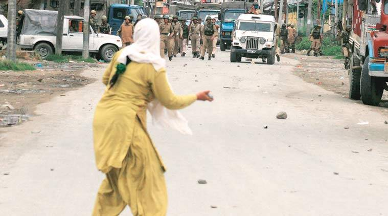 A woman protester takes the lead in downtown Srinagar.