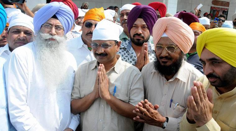 Delhi Chief Minister Arvind Kejriwal paying obeisance at Golden temple in Amritsar on Friday. PTI Photo