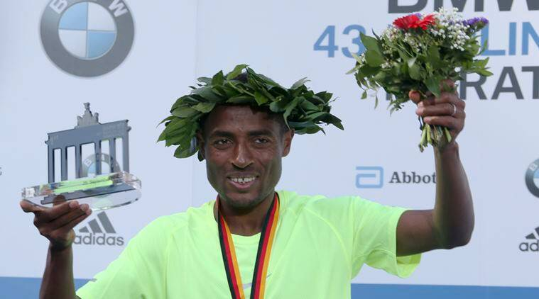 Winner Bekele of Ethiopia celebrates during the victory ceremony at the Berlin marathon in Berlin