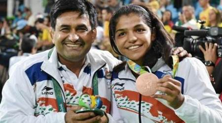 sakshi malik, malik, sakshi, sakshi malik coach, sakshi malik coach rewards, kuldeep malik sakshi malik, kuldeep malik rewards, haryana government, sports news