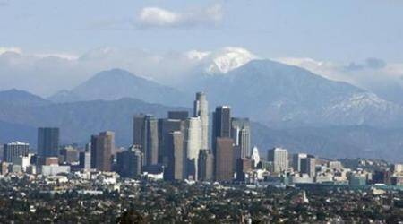 Downtown Los Angeles is shown in front of snow-capped mountains on rare smog-free day