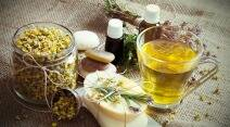 Ingredients for Natural Spa Treatment. Organic Camomile in jar, Camomile Tea, Pebbles , Handmade Soaps, Oil and Herbs