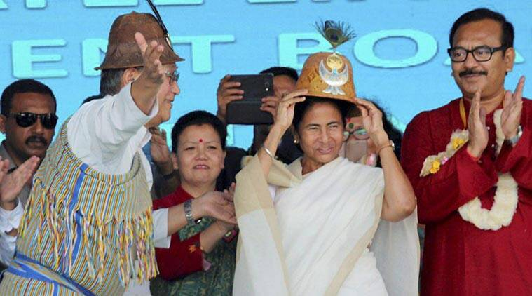 West Bengal Chief Minister Mamata Banejee wears a traditional headgear at the 5th founation day function of Lepcha Development and Cultural Board at Kalimpoog in Darjeeling on Thursday. (Source: PTI Photo)