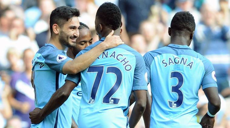 Manchester City's Ilkay Gundogan, left, celebrates with teammates after scoring during the English Premier League soccer match between Manchester City and Bournemouth at the Etihad Stadium in Manchester, England, Saturday, Sept. 17, 2016. (AP Photo/Rui Vieira)