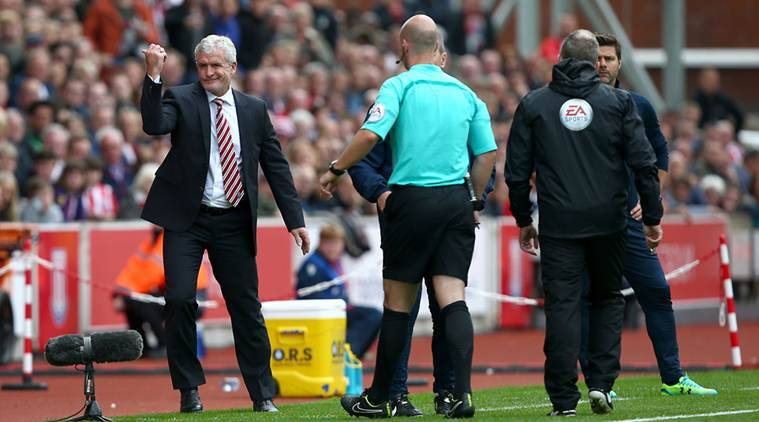 Stoke City manager Mark Hughes is sent to the stands by referee Anthony Taylor for shouting at the Tottenham Hotspur fans during their English Premier League soccer match at The Bet365 Stadium, Stoke-on-Trent, England, Saturday, Sept. 10, 2016. (Dave Thompson/PA via AP)