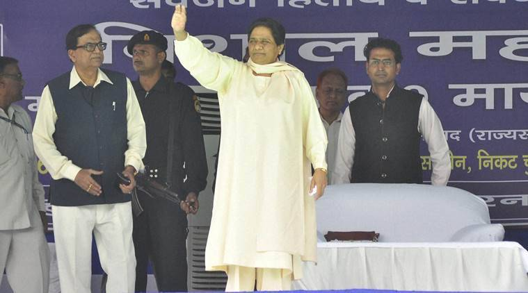 Saharanpur : BSP chief Mayawati waves at party workers at a party meeting in Saharanpur on Sunday. PTI Photo (PTI9_11_2016_000166B)