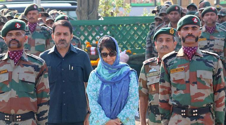 Srinagar: J&K CM Mehbooba Mufti  paying tribute to Army soldiers who were killed in Uri attack, at a wreath laying ceremony in Srinagar on Monday. PTI Photo  (PTI9_19_2016_000167A) *** Local Caption ***