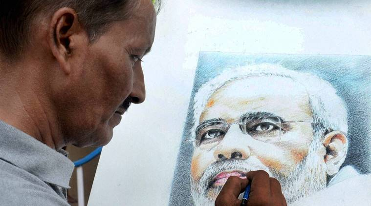 Kolkata: Renowned painter Partha Das gives final touch to a potrait of Prime Minister Narendra Modi on the eve of Modi's birthday at BJP state party office in Kolkata on Friday. PTI Photo(PTI9_16_2016_000207A)