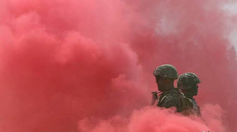 "South Korea and U.S. Marines stand in smoke during the 66th Incheon Landing Operations Commemoration ceremony in Incheon, South Korea, Friday, Sept. 9, 2016. Incheon is the coastal city where the United Nations Forces led by U.S. Gen""ÄÇ Douglas MacArthur landed in September, 1950 just months after North Korea invaded the South. North Korea said Friday it conducted a ""higher level"" nuclear warhead test explosion, which it trumpeted as finally allowing it to build ""at will"" an array of stronger, smaller and lighter nuclear weapons. It is Pyongyang's fifth atomic test and the second in eight months. (AP Photo/Lee Jin-man)"