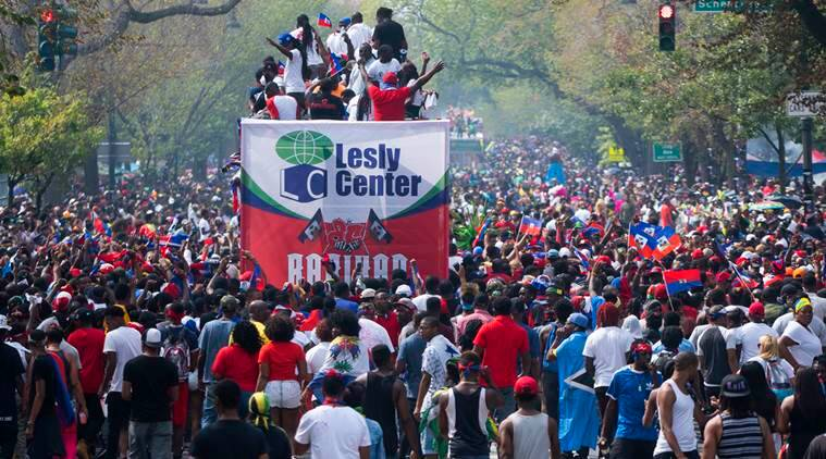 Participants and spectators gather during the West Indian Day Parade in the Brooklyn borough of New York, Monday, Sept. 5, 2016. (AP Photo/Craig Ruttle)
