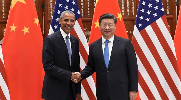 U.S. President Barack Obama, left, and Chinese President Xi Jinping pose for photographers as they shake hands before their meeting at the West Lake State Guest House in Hangzhou in eastern China's Zhejiang province Saturday, Sept. 3, 2016. (Wang Zhao/Pool Photo via AP)