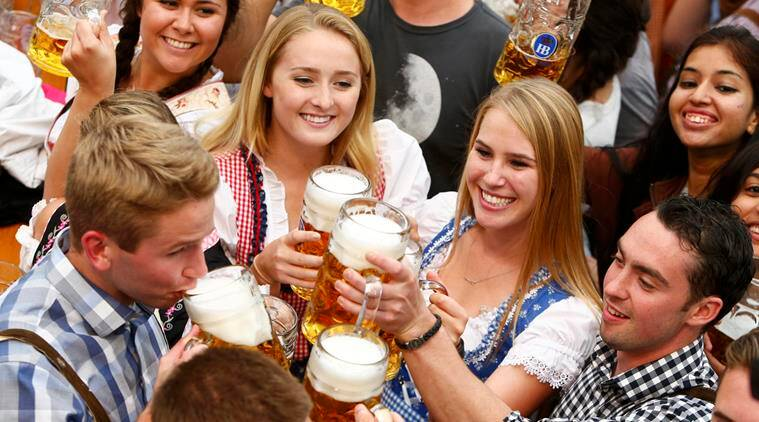 Visitors cheer with beer during the opening day of the 183rd Oktoberfest in Munich, Germany. (Source: Reuters)