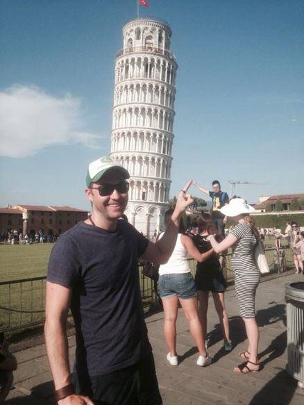 This guy photobombed others by strategically posing with them in front of the Leaning Tower of Pisa
