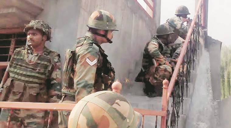 Security personnel position themselves to counter gunfire at Poonch.