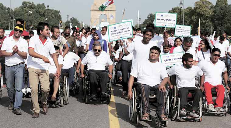 Union Minister Harsh Vardhan with participants during the flagoff of the rally at Rajpath Sunday. (Express Photo: Amit Mehra)
