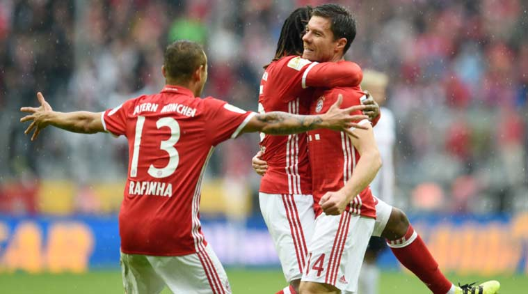 Bayern come back to beat Ingolstadt and stay top of table