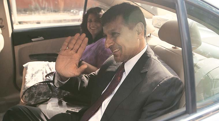 RBI Governor Raghuram Rajan leaves St Stephens's College after attending a function with his wife in New Delhi  on Saturday.  (Express Photo by Tashi Tobgyal)