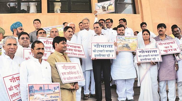 Former Chief Minister Ashok Gehlot along with Leader of Opposition Rameshwar Dudi and others protest outside the Vidhan Sabha, in Jaipur on Friday. Express Photo by Rohit Jain Paras