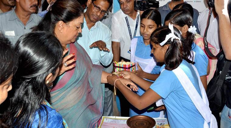 Jaipur: Rajasthan Chief Minister Vasundhara Raje spends time with students on the occasion of Teacher's Day in Jaipur on Monday. PTI Photo     (PTI9_5_2016_000239A)