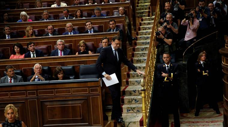 Spain's acting Prime Minister and People's Party leader Mariano Rajoy walks to give a speech during an investiture debate at parliament in Madrid, Spain, September 2, 2016. REUTERS/Susana Vera