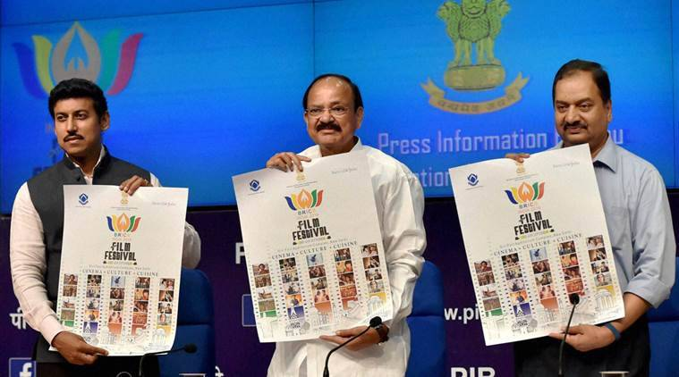 New Delhi: Union Minister for Information and Broadcasting, M Venkiah Naidu, MoS for I&B Rajyavardhan Singh Rathore and DG PIB Frank Naronha release a poster on BRICS film festival during a press conference at national media centre in New Delhi on Wednesday. PTI Photo by Vijay Verma (PTI8_24_2016_000157B)