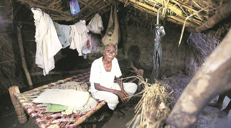 85 years old Ram Nath of Ekla Mushrauba village enjoying on Rahul Gandhi's Cot Meeting cot at his hut,acoring the the Ram Nath he sleep first time on cot after he grab this cot from AICC Vice president Rahul Gandhi's cot Meeting.Express photo by Vishal Srivastav 14.09.2016