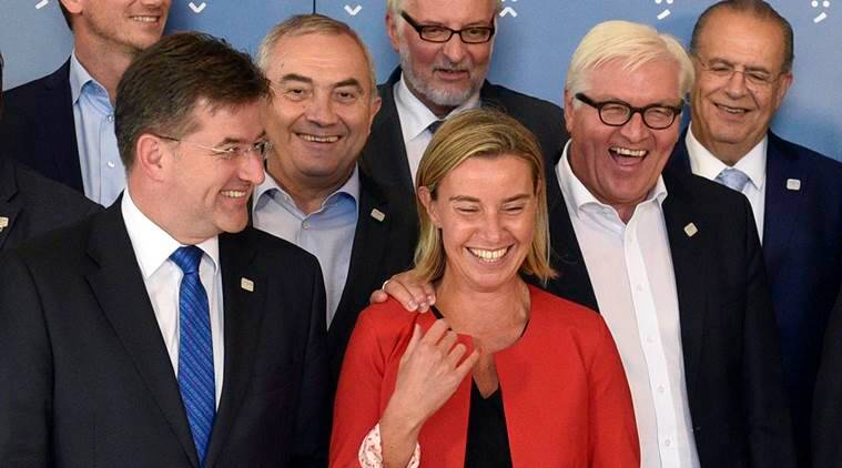 From left: Miroslav Lajcak, Foreign Minister of Slovakia, Lazar Comanescu, Foreign Minister of Romania, Witold Waszczykowski, Foreign Minister of Poland, Federica Mogherini, High Representative of the EU, Frank-Walter Steinmeier, Foreign Minister of Germany, Ioannis Kasoulidis Foreign Minister of Cyprus  pose for a group photo during an informal meeting of EU Foreign Ministers in Bratislava, Slovakia on Friday, Sept. 2, 2016.  (AP Photo/Hans Punz)