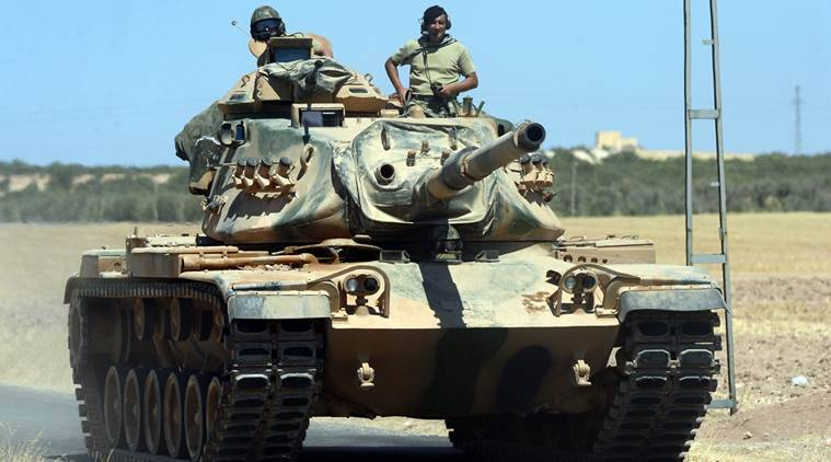 In this photo taken on Friday, Sept. 2, 2016, A Turkish tank heads to the Syrian border, in Karkamis, Turkey. Turkish troops and allied Syrian rebels expelled the Islamic State group from the last strip of territory it controlled along the Syrian-Turkish border on Sunday, effectively sealing the extremists' self-styled caliphate off from the outside world, Turkey's state-run news agency reported.(Ismail Coskun/IHA via AP)