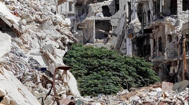 """Damaged buildings and rubble line a street in the Old City, Homs, Syria, Sept. 19, 2016. Syria's military command has declared the U.S-Russian brokered cease-fire over, blaming the rebel groups for undermining it. In a statement Monday, the Syria military said """"the armed terrorist groups"""" repeatedly violated the cease-fire which came into effect last week. (AP PHOTO)"""
