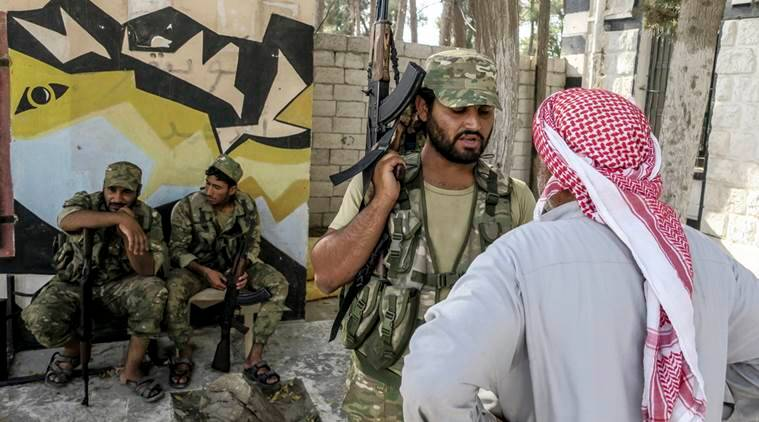 "Free Syrian Army fighters in Jarablus, Syria, Wednesday, Aug. 31, 2016. Turkish military officials say Turkish jets have struck four buildings in Syria's Islamic State group-held Zaghrah and Kuliyeh regions, destroying the edifices as well as ""terrorists"" inside. The officials also said Wednesday that Turkish artillery had fired 107 rounds at 25 ""terrorist"" targets in the villages of Zavgar and Kuliyeh since Tuesday. The villages are situated west of the key border town of Jarablus which was retaken by Turkey-backed Syrian rebels. (AP Photo)"