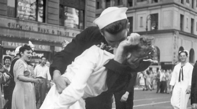 In this August 14, 1945 file photo provided by the U.S. Navy, a sailor and a nurse kiss passionately in Manhattan's Times Square, as New York City celebrates the end of World War II. (AP Photo/U.S. Navy/Victor Jorgensen, File)